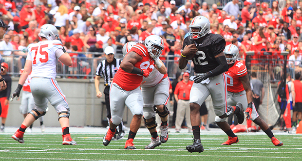Redshirt-junior quarterback Cardale Jones (12) threw for 304 yards and 2 touchdowns during OSU's Spring Game on April 18 at Ohio Stadium, but completed just 19-of-42 passes and added 2 interceptions. Credit: Samantha Hollingshead / Lantern photographer