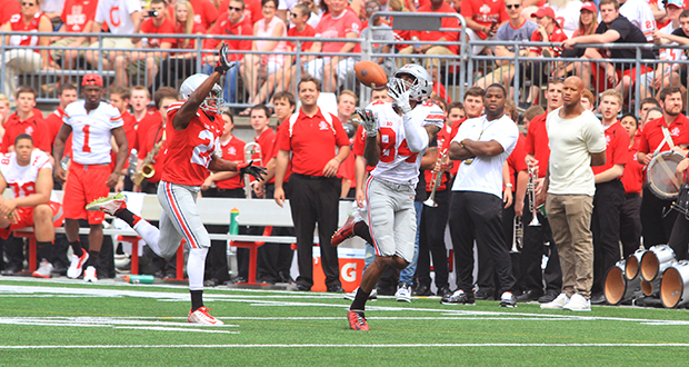 Redshirt-senior wide receiver Corey Smith (84) had 6 catches for 174 yards and 2 touchdowns during OSU's annual Spring Game on April 18 at Ohio Stadium. His 37-yard touchdown with 3:43 to play sealed the 17-14 win for the Scarlet team. Credit: Samantha Hollingshead / Lantern photographer