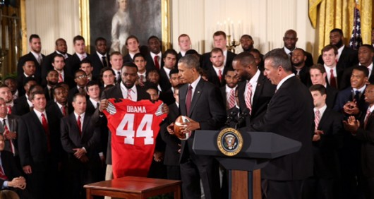 Members of the 2015 College Football Playoff National Champion Ohio State Buckeyes present President Barack Obama with a No. 44 jersey on a visit to the White House on April 20. Credit: Courtesy of Kevin Fitzsimons