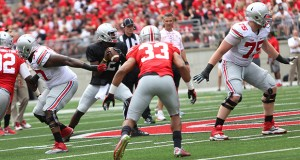 Members of Ohio State's offensive line block for redshirt-junior quarterback Cardale Jones during the 2015 Spring Game. Gray defeated Scarlet, 17-14. Credit: Samantha Hollingshead / Lantern photographer