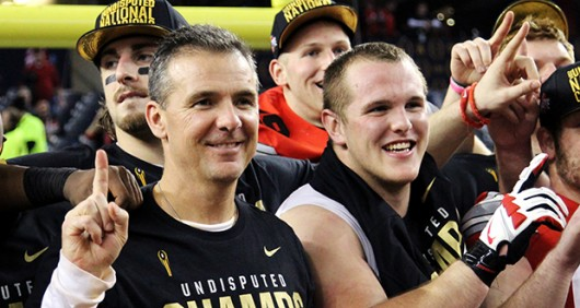 OSU redshirt junior guard Billy Price celebrates with coach Urban Meyer after the 2014 national championship victory. Credit: Lantern File Photo