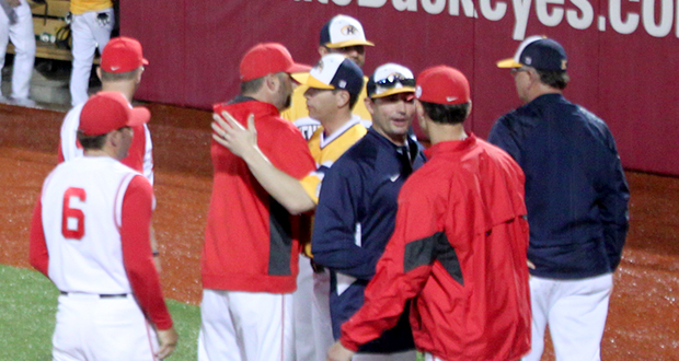 OSU and Kent State coaches and players shake hands after the cancellation of an April 8 game at Bill Davis Stadium. The game was cancelled after the 4th inning due to weather.  Credit: Zoe Chrysochoos / Lantern photographer