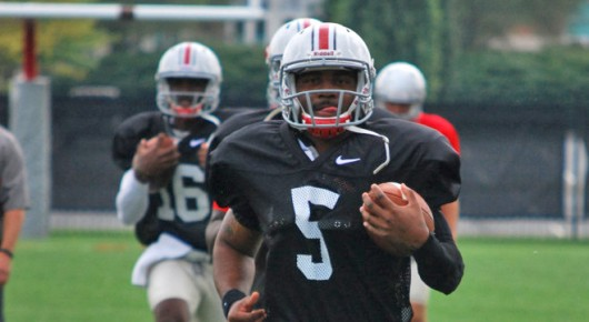 Redshirt senior Braxton Miller (5) carries the ball during a spring practice. Miller announced on Thursday his intentions to switch to H-back for his final season. Credit: Lantern file photo