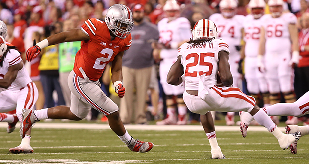 Then-freshman linebacker Raekwon McMillan (2) attempts to make a tackle during a game against Wisconsin on Dec. 6 in Indianapolis. OSU won, 59-0. Credit: Mark Batke / Photo editor
