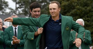 Bubba Watson (left) helps Jordan Spieth into his green jacket after Spieth won the Masters on April 12 at Augusta National Golf Club in Augusta, Ga.