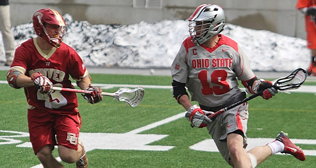 Senior midfielder Jesse King (19) prepares to take a shot during a game against Denver on March 14 at Ohio Stadium. OSU won, 13-11. Credit: Molly Tavoletti / Lantern reporter