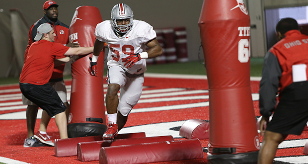 Redshirt-sophomore defensive lineman Tyquan Lewis (59) performs a drill during a March 26 practice at the Woody Hayes Athletic Center. Credit: Mark Batke / Photo editor