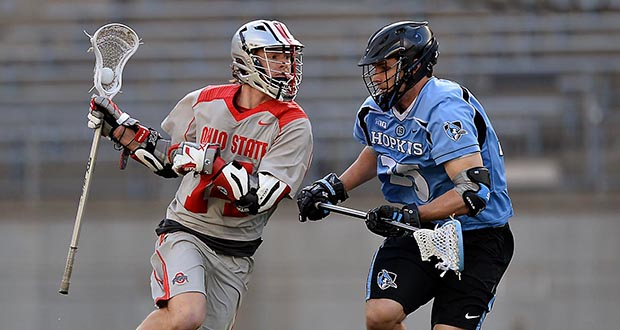 OSU junior attackman Carter Brown (14) scored six goals in the Buckeyes' 15-12 win against Johns Hopkins on March 5 at Ohio Stadium.  Credit: Courtesy of OSU athletics