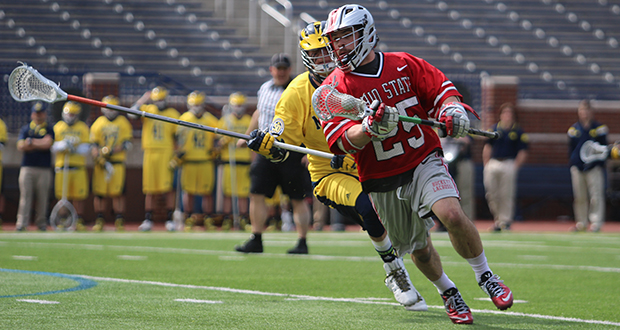 Senior midfielder Christopher May (25) carries the ball during a game against Michigan on April 12 in Ann Arbor, Mich. OSU won, 13-8. Credit: Molly Tavoletti / Lantern reporter