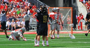 OSU men's lacrosse had a 9-5 lead with less than 5 minutes to play on April 18 at Ohio Stadium, but Maryland scored 5 unanswered goals to win, 10-9, in overtime. Credit: Samantha Hollingshead / Lantern photographer