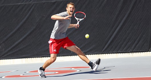 Senior Kevin Metka prepares to hit the ball during a match against Purdue on April 12 at the Varsity Tennis Courts. OSU won, 4-0. Credit: Mark Batke / Photo Editor