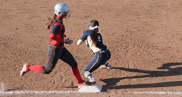 Senior outfielder Caitlin Conrad (left) arrives safely at 1st base during a game against Pittsburgh on March 31. OSU won, 7-3. Credit: Stacie Jackson / Lantern photographer
