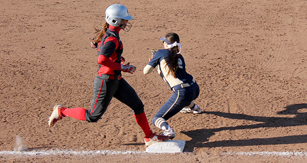 Senior outfielder Caitlin Conrad (left) arrives safely at 1st base during a game against Pittsburgh on March 31 at Buckeye Field. OSU won, 7-3. Credit: Stacie Jackson / Lantern Photographer