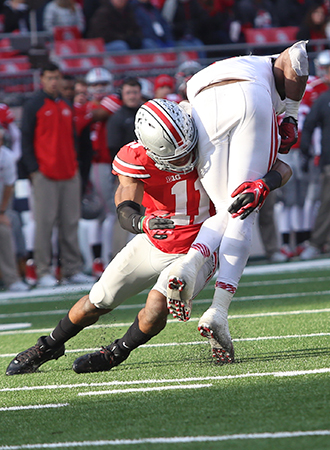 Then-sophomore safety Vonn Bell (11) makes a tackle during a game against Indiana on Nov. 22 at Ohio Stadium. OSU won, 42-27. Credit: Mark Batke / Photo editor