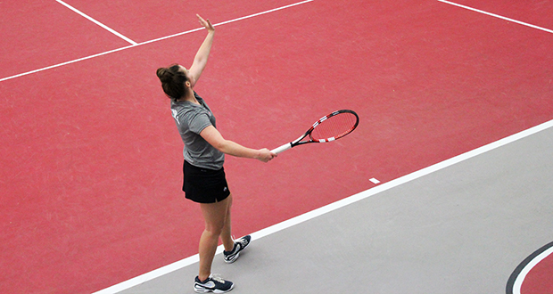 Junior Grainne O'Neill serves during a match at the OSU tennis center. The Buckeyes are set for the Big Ten tournament. Credit: Lindsey Oates / Lantern photographer