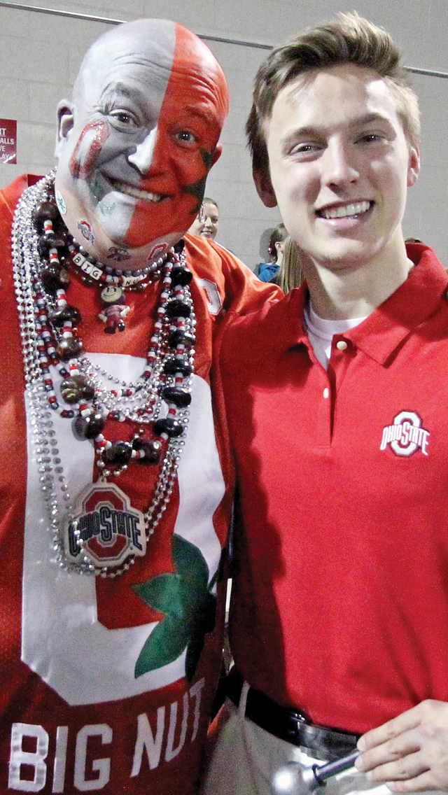 Drum major candidate John LaVange smiles with buckeye fan 'The Big Nut' during tryouts on April 25 at the Woody Hayes Athletic Center. Credit: Elliot Gilfix /  For The Lantern