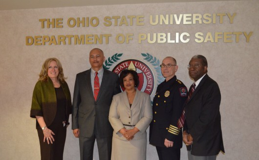 """(From left) Andraea """"AJ"""" Douglass, Deputy Chief Craig Stone, Craig's wife Cathy, Chief Paul Denton, and OSU Department of Public Safety Director Vernon Baisden on May 1 for Stone's swearing in as newest deputy chief of University Police. Credit: Robert Scarpinito / Lantern Reporter"""