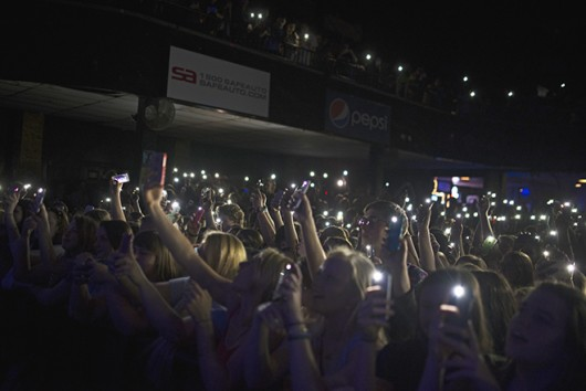 Fans hold up their phones as lights for a song during the Kodaline concert May 19 at Newport Music Hall. Credit: Judy Won / Lantern Photographer