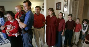 Duggar family members wait to greet a television crew at their home. Credit: Courtesy of TNS