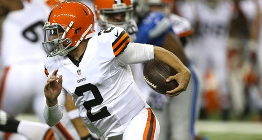 Cleveland Browns quarterback Johnny Manziel (2) evades the Detroit Lions' Kyle Van Noy during the second quarter in exhibtion action on Aug. 9, 2014, at Ford Field in Detroit.  Credit: Courtesy of TNS