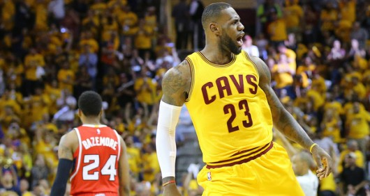 Cleveland Cavaliers' LeBron James reacts after stealing the ball from the Atlanta Hawks and driving the court for a slam as Hawks' Kent Bazemore walks away during Game 4 of the Eastern Conference Finals on May 26 at Quicken Loans Arena in Cleveland.  Credit: Courtesy of TNS