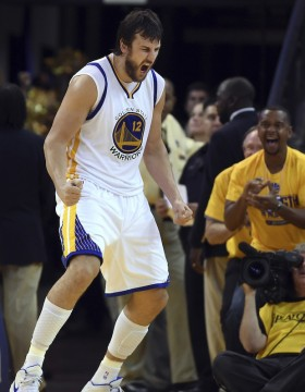 The Golden State Warriors' Andrew Bogut (12) lets out a yell after scoring against the Houston Rockets in the fourth quarter of Game 2 of the NBA Western Conference finals at Oracle Arena on May 21 in Oakland, Calif. The Warriors won 99-98. Credit: Courtesy of TNS