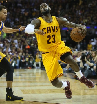 The Cleveland Cavaliers' LeBron James (23) drives to the basket against the Golden State Warriors' Stephen Curry during the first quarter in Game 4 of the NBA Finals at Quicken Loans Arena in Cleveland on Thursday, June 11, 2015. Credit: Courtesy of TNS
