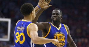 The Golden State Warriors' Draymond Green (23) high-fives teammate Stephen Curry (30) after a play against the Houston Rockets in the second quarter during Game 3 of the NBA Western Conference finals at the Toyota Center in Houston on May 23. The Warriors won, 115-80, for a 3-0 series lead. Credit: Courtesy of TNS