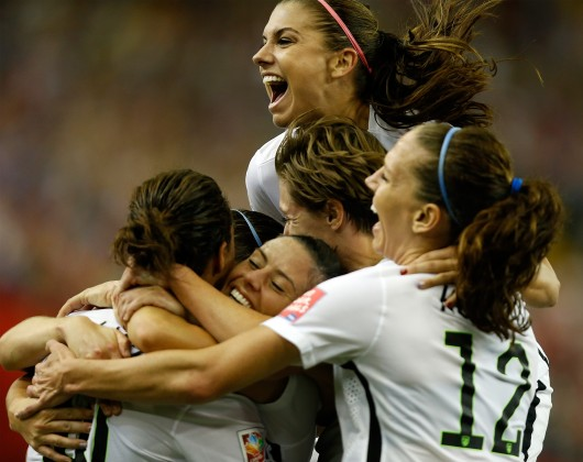 June 30, 2015 - Montreal, Canada - Players of the United States celebrate scoring during the semifinal between Germany and the United States at the 2015 FIFA Women's World Cup. The United States beat Germany 2-0 and moves on to the Final.  Credit: Courtesy of TNS.