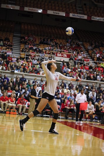 Then-junior Elizabeth Campbell (14) prepares to serve a ball during a game against Penn State on Oct. 31, 2014. Credit: Lantern File Photo