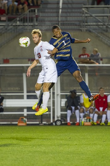 OSU sophomore forward Christian Soldat (13) goes up to head a ball during a game against Akron on Sept. 24 at Jesse Owens Memorial Stadium. OSU lost, 3-1. Credit: Lantern File Photo