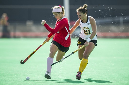 Then-freshman forward Maddy Humphrey (left) pushes the ball upfield during a game against Iowa Oct. 19, 2014 at Jesse Owens Memorial Stadium. OSU lost 4-2. Credit: Lantern File Photo