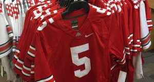 A rack of OSU jerseys is seen at Barnes & Noble at 1598 N. High St. For the 2015 season, stores such as Barnes and Noble will only be allowed to sell Nos. 1 and 15 jerseys. Credit: Giustino Bovenzi / Lantern reporter