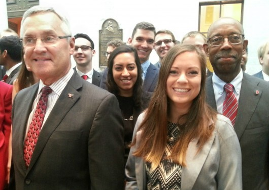 Youngstown State University President Jim Tressel (left) and University President Michael Drake (right) pose with Ohio university students Aug. 6 at the 2015 Ohio Export Internship Program Showcase. Credit: Michael Huson / Campus Editor