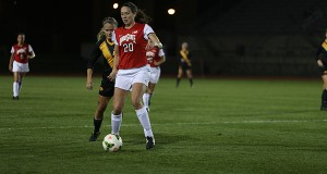 Then sophomore forward Lindsay Agnew (20) maintains possession during a match Oct. 24, 2014 against Iowa at Jesse Owens Memorial Stadium. Credit: Lantern File Photo