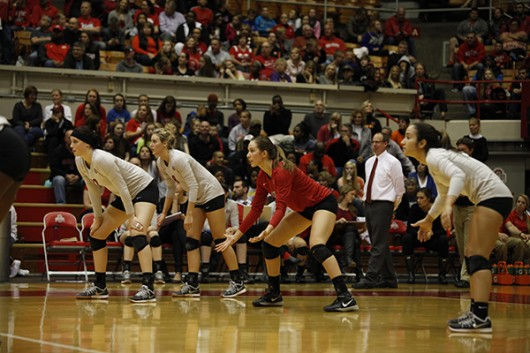 OSU women's volleyball players get set for a serve during a game against Penn State on Oct. 31, 2014.  Credit: Lantern File Photo