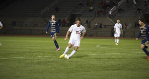 OSU freshman defender Hunter Robertson (21) dribbles a ball during a game against Akron on Sept. 24 at Jesse Owens Memorial Stadium. OSU lost, 3-1. Credit: Lantern File Photo