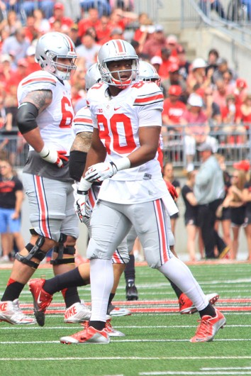 Sophomore wide receiver Noah Brown (80) walks across the field during OSU's 2015 Spring Game on April 18. Credit: Samantha Hollingshead / Photo Editor