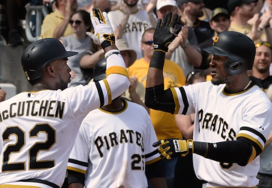 Pittsburgh Pirates outfielder Starling Marte is greeted at home by Andrew McCutchen after hitting a three-run homer against the New York Mets on May 24, 2015, at PNC Park in Pittsburgh. Credit: Courtesy of TNS