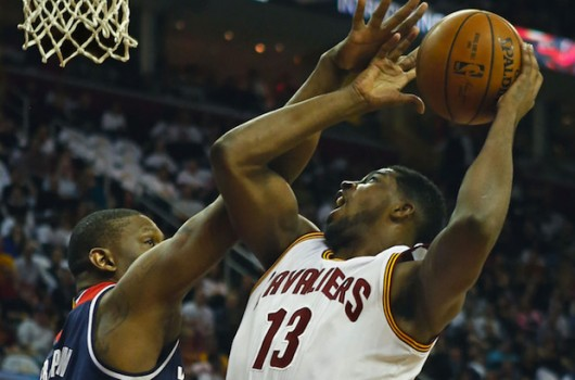 The Cleveland Cavaliers' Tristan Thompson (13) puts up a shot against the Washington Wizards' Kevin Seraphin in the second quarter at Quicken Loans Arena in Cleveland on Wednesday, April 15, 2015. Credit: Courtesy of TNS