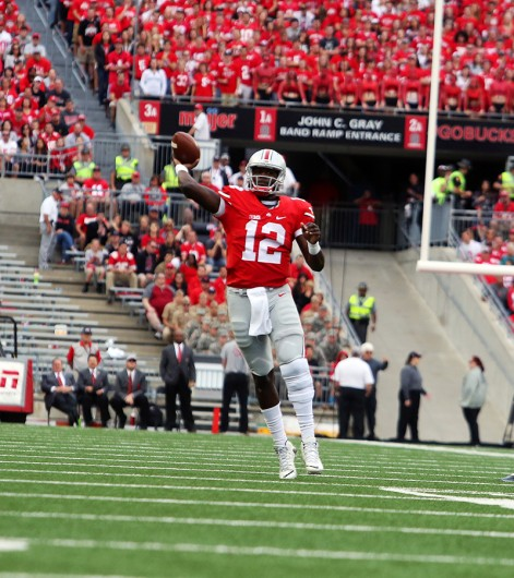 OSU redshirt junior quarterback Cardale Jones (12) attempts a pass during a game against Western Michigan at Ohio Stadium on Sept. 26. OSU won, 38-12. Credit: Muyao Shen / Asst. Photo Editor