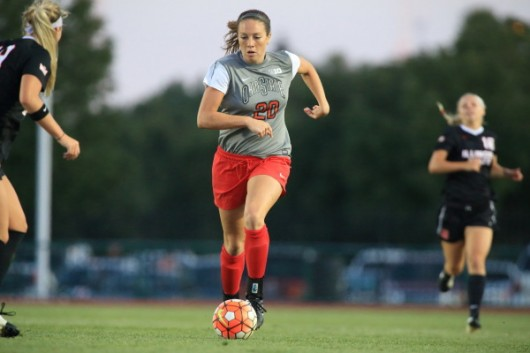 Junior forward Lindsay Agnew (20) maintains possession during a match against Illinois State on Aug. 21. Credit: Courtesy of OSU