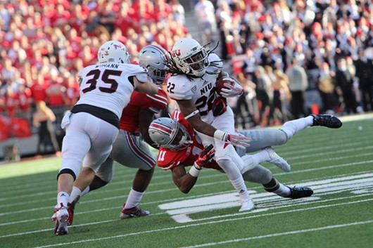 Junior safety Vonn Bell (11) attempts to tackle an Northern Illinois player during a game on Sept. 19. OSU won 20-13. Credit: Samantha Hollingshead / Photo Editor