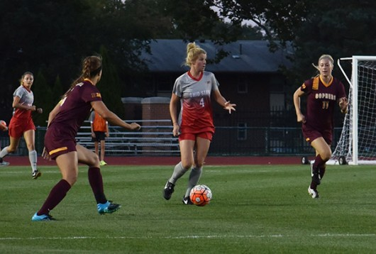 OSU sophomore midfielder Nikki Walts (4) dribbles the ball during a game agaisnt Minnesota on Sept. 17 at Jesse Owens Memorial Stadium. OSU lost 2-1. Credit: Sam Harris / Lantern photographer