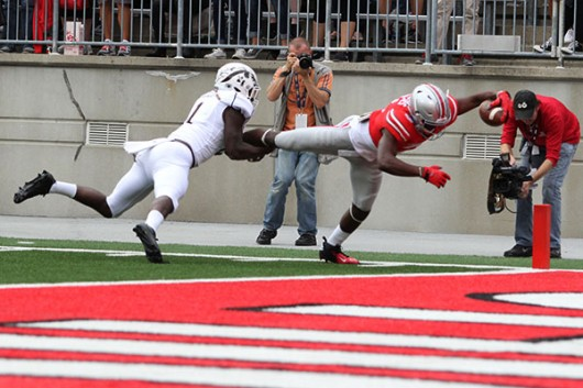 OSU redshirt junior wide receiver Michael Thomas (3) dives towards the end zone during the first quarter of a game against Western Michigan at Ohio Stadium on Sept. 26. OSU won, 38-12. Credit: Samantha Hollingshead / Photo Editor