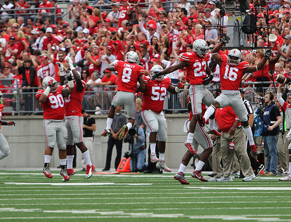 Members of the Ohio State football team celebrate during a game against Western Michigan on Sept. 26. OSU won 38-12. Credit: Samantha Hollingshead / Photo Editor