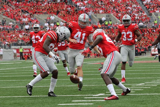 Members of the OSU punt coverage team down a punt in a game against Western Michigan at Ohio Stadium on Sept. 26. OSU won, 38-12. Credit: Samantha Hollingshead / Photo Editor