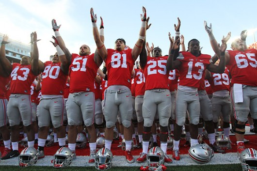"Members of the Ohio State football team take part in ""Carmen Ohio"" after shutting out Hawaii 38-0 on Sept. 12. Credit: Lantern File Photo"