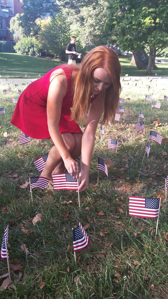 Morgan Shafley, a third-year in animal sciences, places an American flag on the South Oval during Friday's 9-11 memorial. Photo by Joely Friedman