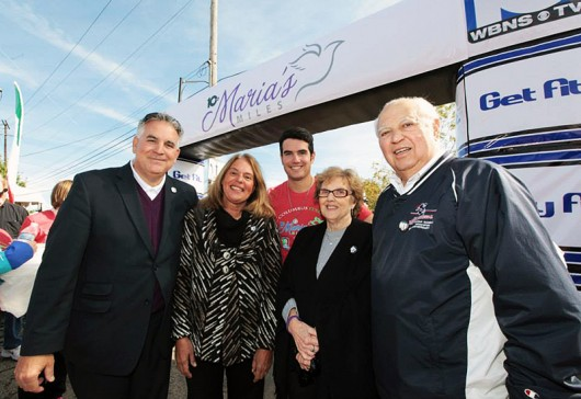 The Tiberi family at the 2014 Maria's Miles event at the finish line. From left to right: Dom, Terri, Dominic, Louis and Betty Tiberi. Credit: Courtesy of M3S Sports
